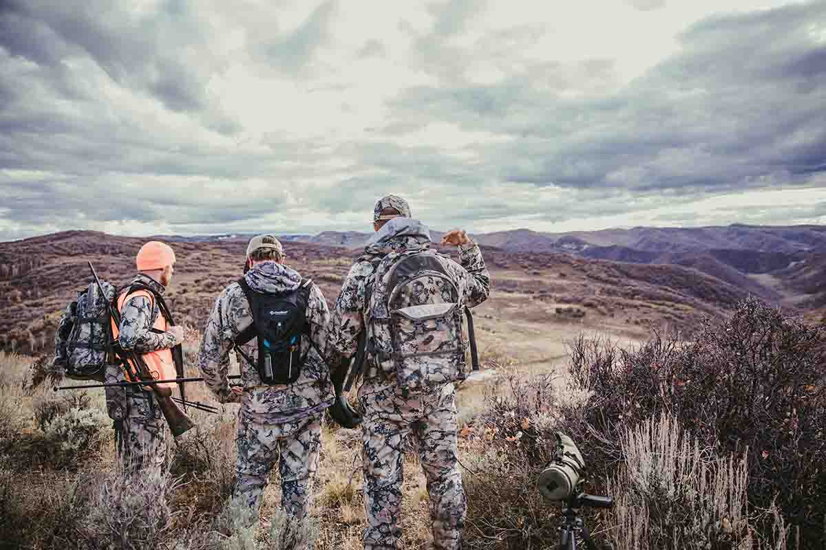 Darron and his two guides discuss a game plan on the first afternoon of the hunt.